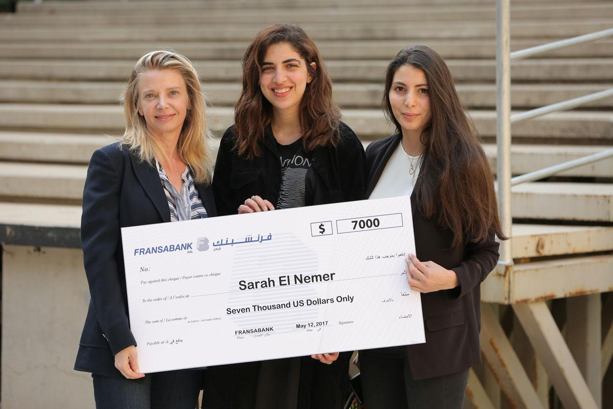 group photo: student receiving check